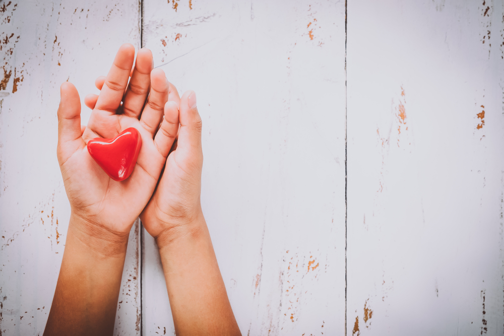 What Is Compassion Focussed Therapy? Heart in Palm of Hand